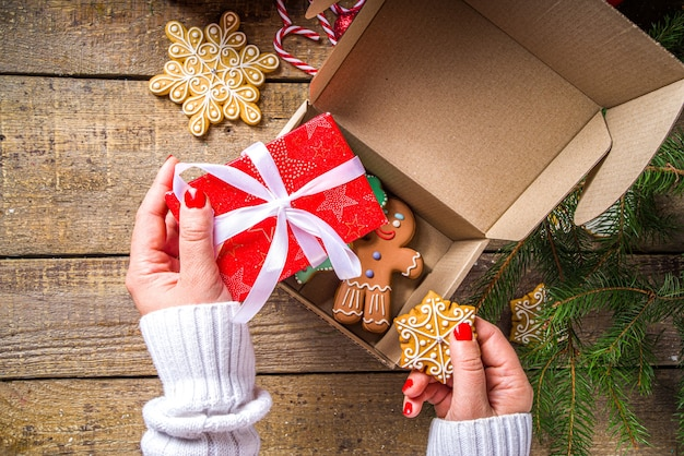Christmas gifts with tree branches and gingerbread cookies