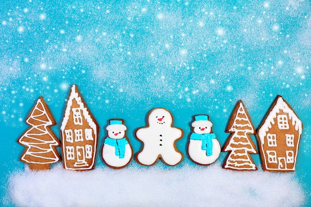 Christmas ginger snowmen and gingerbread houses and fir trees