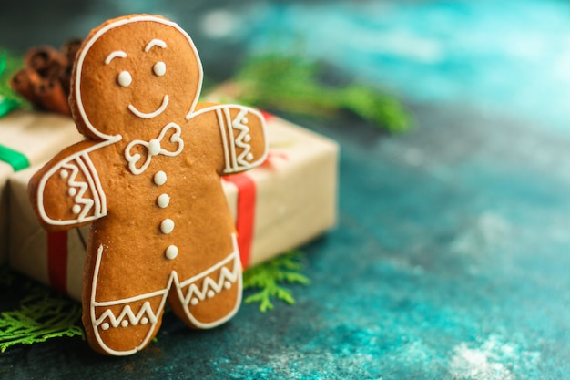Christmas gingerbread cookie on blurred background