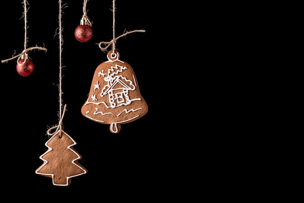Christmas gingerbread cookies on a black surface