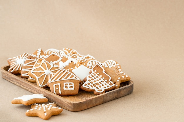 Christmas gingerbread cookies on brown background