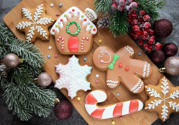 Christmas gingerbread cookies and christmas decorations.   homemade delicious christmas gingerbread on the  wooden background.