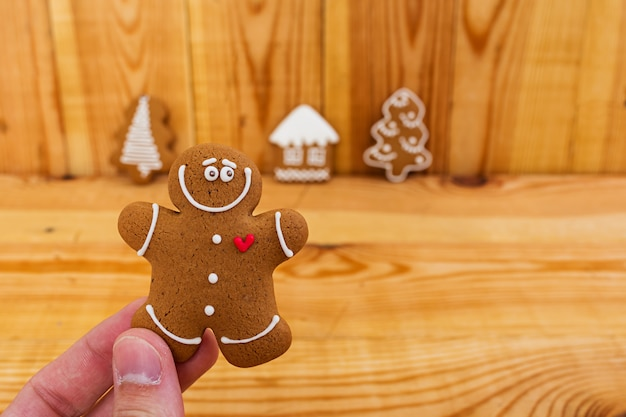 Christmas gingerbread cookies on wooden
