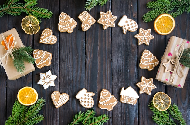Christmas gingerbread of different kinds on a black and white wooden background