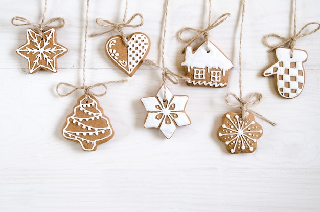 Christmas gingerbread of different kinds on a black and white wooden table