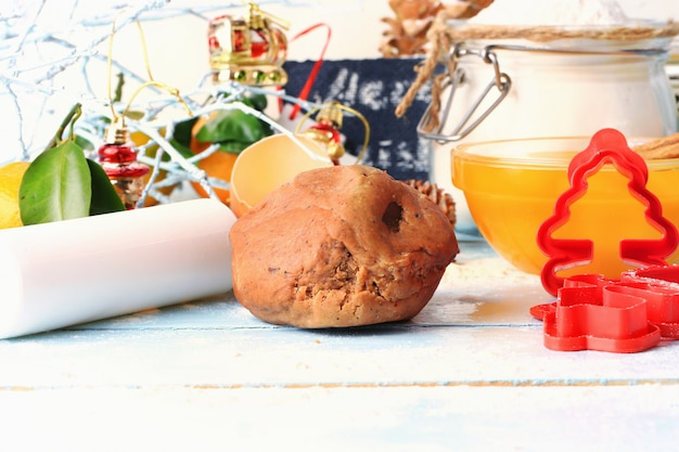 Christmas gingerbread dough for homemade cakes on a light wooden background selective soft focus rustic style