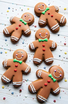 Christmas gingerbread men  on a white wooden background.  homemade delicious christmas gingerbread