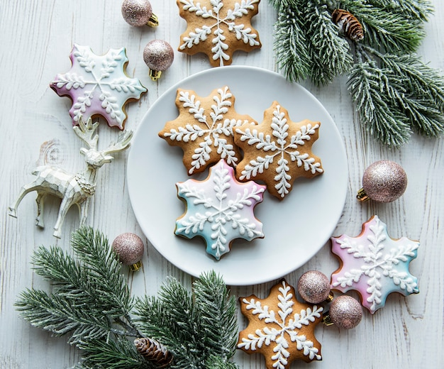 Christmas gingerbread in the plate and holiday decorations