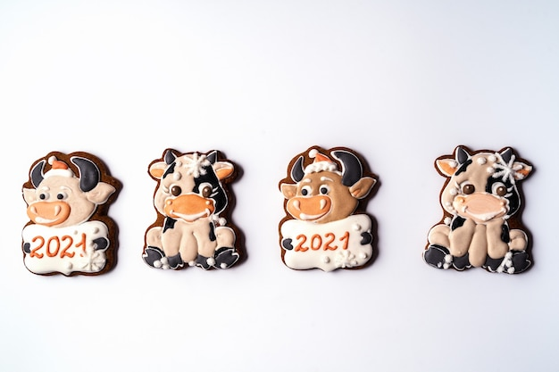 Christmas gingerbread in the shape of bull on white background,flat lay.