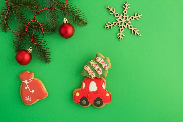 Christmas gingerbread in the shape of  car and gift on the green background. top view. copy space.