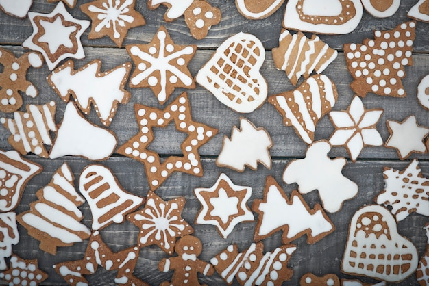 Christmas gingerbread on the wooden desks