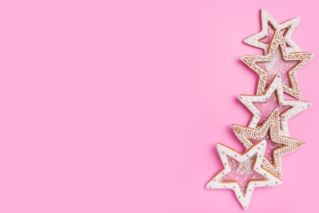 Christmas gingerbreads stars on sweet pink background.top view.