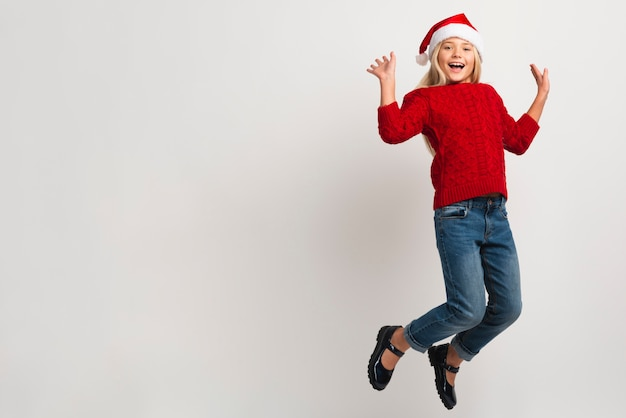 Christmas girl jumping copy space