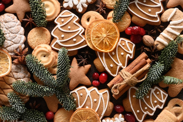 Christmas glazed cookies different shapes cinnamon anise stars red berries orange chips spruce