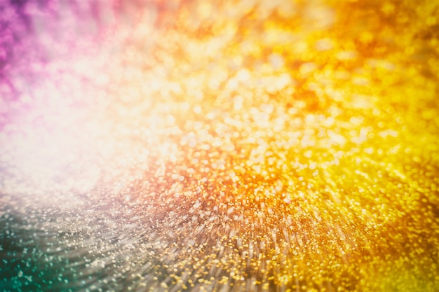 Christmas glowing golden background. christmas lights. gold holiday new year abstract glitter defocused background with blinking stars and sparks.