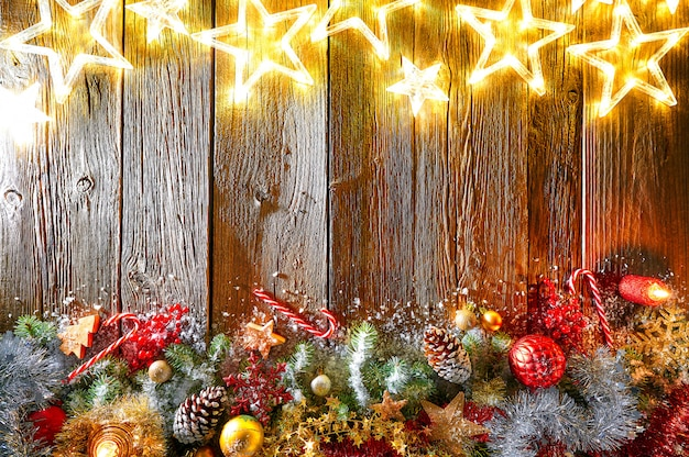 Christmas glowing stars and snowed fir