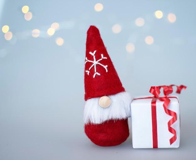 Christmas gnome with a gift christmas card