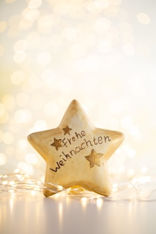 Christmas gold bokeh background with decorative star. christmas gold stars. christmas pattern. background on the gray color. - image
