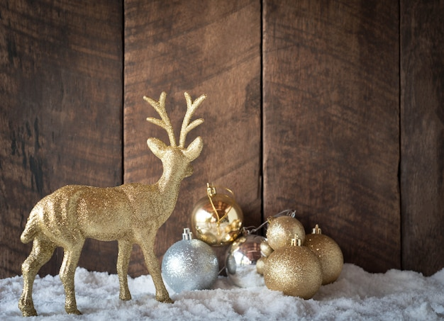 Christmas gold silver ball and reindeer decoration with wood