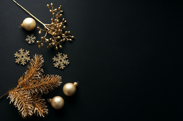 Christmas golden baubles on black. flat lay.