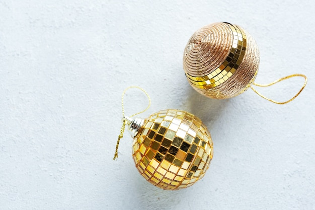 Christmas golden baubles on bright background. flat lay.