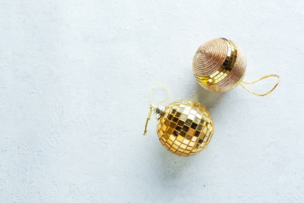 Christmas golden baubles on bright. flat lay.