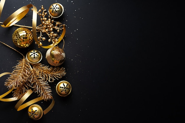 Christmas golden baubles on dark background. flat lay.