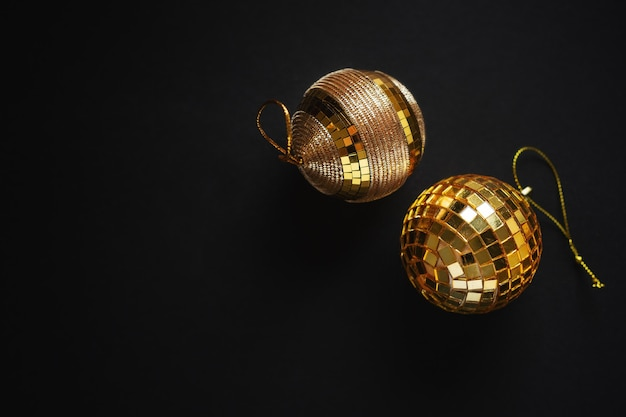 Christmas golden baubles on dark surface
