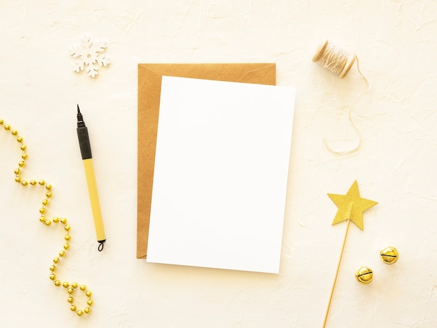 Christmas golden mockup copy space on a paper sheet with pen holiday postcard background top view