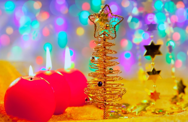 Christmas golden tree baubles and candles