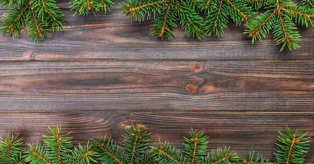 Christmas gray wooden  with fir tree and, top view banner empty space