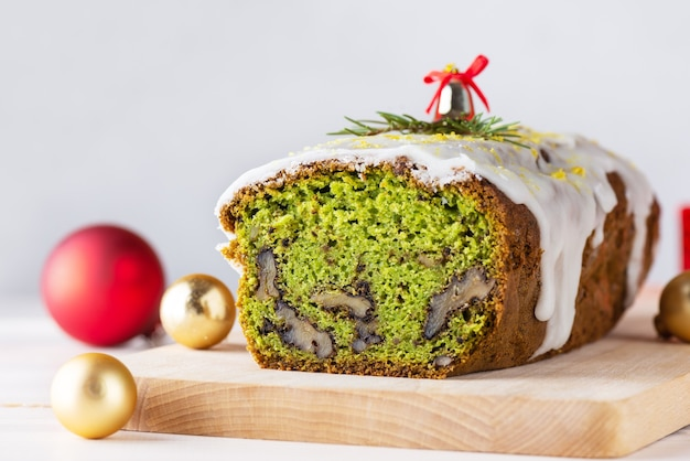 Christmas green cake with spinach walnut and lemon with christmas balls and bell