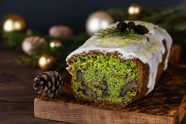 Christmas green muffin with spinach walnut and lemon with christmas balls and pine cones