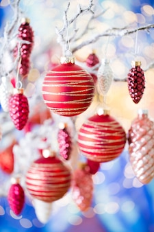Christmas greeting card cone decoration on bokeh background new year concept