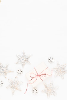Christmas greeting card. festive decoration on white wooden background. new year concept. copy space.  flat lay. top view.