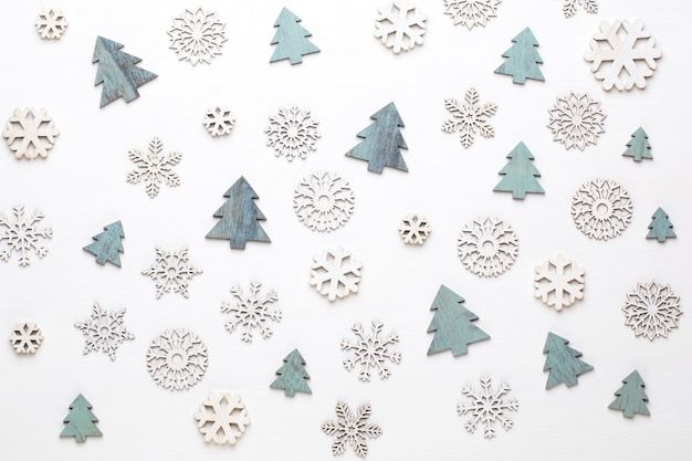 Christmas greeting card. festive decoration on white wooden background. new year concept.  flat lay. top view.