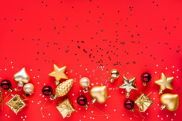 Christmas greeting card. happy new year. christmas ornaments on red background. merry christmas card. space for text.