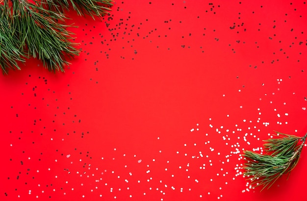 Christmas greeting card. happy new year. christmas tree on red background. merry christmas card. space for text.