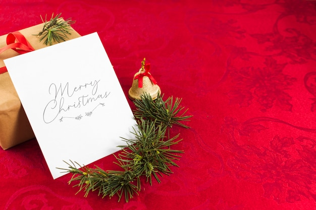Christmas greeting card on red table