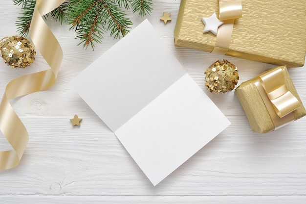Christmas greeting card with gold gift ribbon