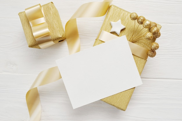 Christmas greeting card with golden gifts