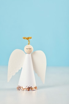 Christmas greeting card with paper angel