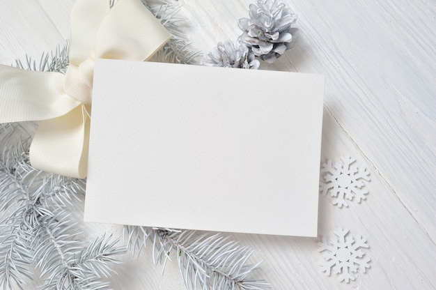 Christmas greeting card with white tree and cone