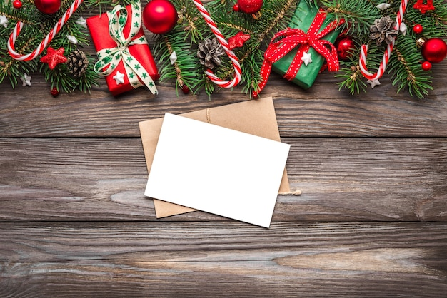 Christmas greeting card on wooden background. mock up. flat lay. top view with copy space