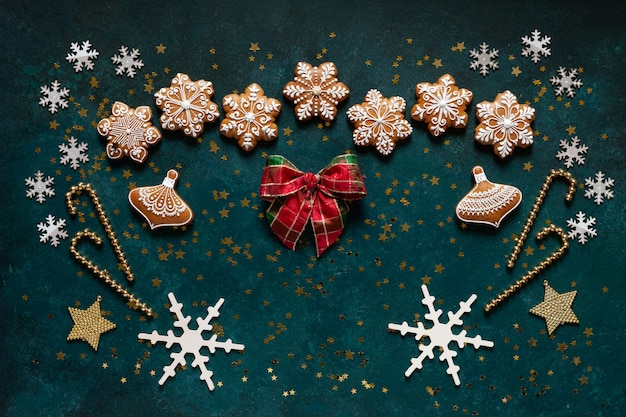 Christmas greeting frame - pattern of gingerbread cookies, snowflakes and christmas decor