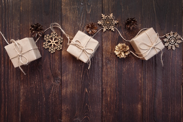 Christmas greetings card. kraft gift boxes with rope and snowflakes, bumps