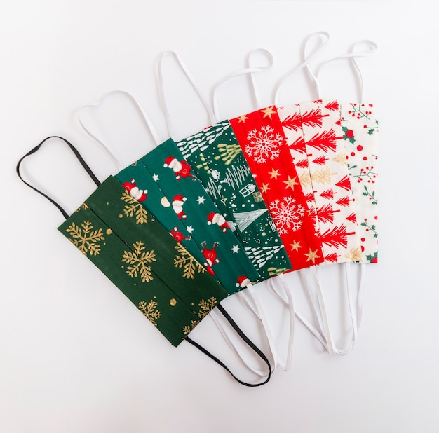 Christmas handmade colorful face masks isolated