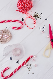 Christmas handmade diy background. red tools and accessories for christmas craft. presents creating background. winter holidays card.