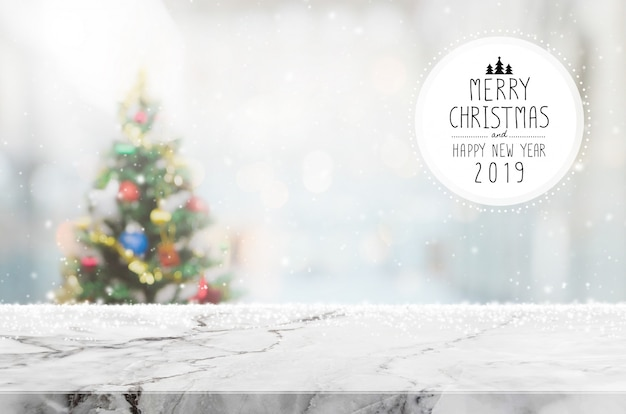 Christmas and happy new year 2019 on empty white marble stone table top on blur bokeh chri