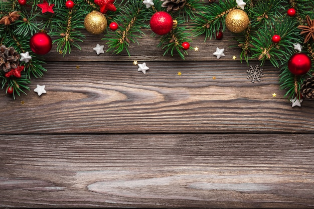 Christmas and happy new year background. fir tree branches and holiday decorations on wooden table